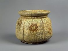 Circa 1535: The oldest Raku example of fresh water jar.    Akoda gourd shape in  (white) kôro glaze w/ chrysanthemums applied in yellow slip.