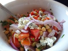 Portuguese Heirloom Tomato and Chick pea salad 1 can Chick Peas 2 large Portuguese tomatoes (or any meaty variety) 1/2 small red onion thinly sliced 2 tbsp chopped olives Salt Pepper 1 – 2 tbsp Olive oil 1 – 2 tbsp Wine Vinegar 2 tbsp chopped parsley Crumbled Blue Cheese, Gorgonzola, farmers cheese