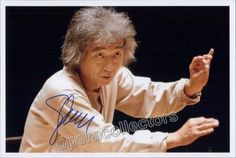 Ozawa, Seiji - signed photo shown conducting