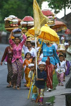 Women and children in procession to the temple, Bali, Indonesia