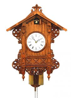 The wood casing is stained in walnut and detailed with intricately carved elements. The solid-wood cuckoo calls the … Clock Shop, Diy Clock, Swiss Clock, Clock Sound, Retro Interior Design, Classic Clocks, Pine Cone Decorations, Wall Clock Online, Clocks For Sale