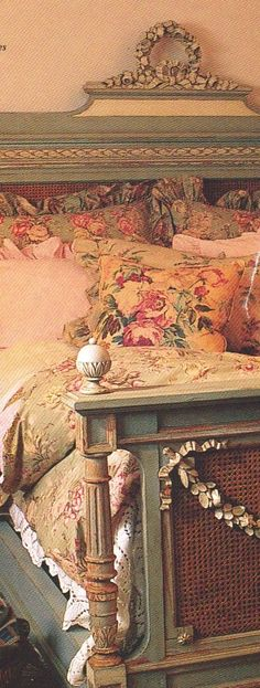Pretty carved bed - so beautifully shabby.