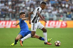 Alex Sandro (R) of Juventus FC is challenged by Lorenzo Pellegrini of US…