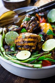 Grilled Tandoori Chicken- an easy authentic Indian recipe with a simple yogurt marinade using chicken thighs. Served with naan and Raita Sauce. #tandoorichicken #grilled #grilledchicken #indianrecipe