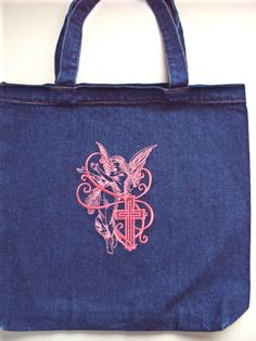 Items similar to Christian Easter or Bible denim tote bag embroidered with beautiful golden angels and rose colored angel and cross on the other on Etsy Bible Bag, Christian Easter, Denim Tote Bags, Totes, Reusable Tote Bags, Sewing, Trending Outfits, Unique Jewelry, Handmade Gifts