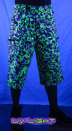 Cyber Shorts : Lime Mayan Fully printed men's 3/4 length shorts. Featuring: 2 front pockets, 2 zip pockets on leg & 2 zip back pockets. Elasticated waistband for super comfy fit, plastic key holder. Secure clip & magnetic closing on waistband. UV Active ! 100% cotton. Artwork by Adi Psychedelic Fashion, Long Shorts, Cyber, Parachute Pants, Lime, Comfy, Plastic, Key, Pockets