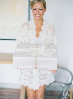 One very romantic Groom gave his very sweet bride a big box containing: something old, something new, something borrowed, something blue. Super sweet story...