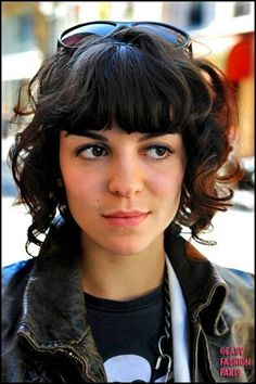 Short shoulder length curly hair style with bangs :: blunt bangs not for me, but length here is good & I like the layering.