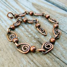 Swirls and Bead links - antiqued copper wire wrap bracelet by wanting