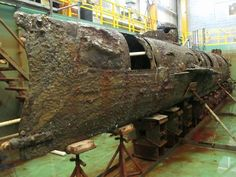 H Hunley Civil War | The Confederate submarine H.L. Hunley sits in a conservation tank ...