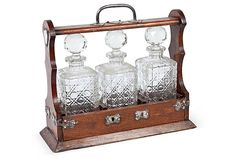 Victorian Oak Tantalus With Silverplate Mounts Holding Three Faceted Crystal Bottles