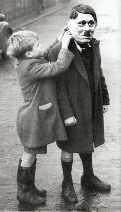 William Vanderson - Hitler Mask. A young boy adjusts his friend's Adolf Hitler…