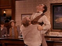 Hoss squeezes the stuffing out of the man who nearly beat Little Joe to death. From The Magnificent Adah (Bonanza)