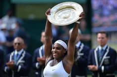 US player Serena Williams celebrates with the winner's trophy, the Venus Rosewater Dish, after her women's singles final victory over Spain's Garbine Muguruza on day twelve of the 2015 Wimbledon Championships at The All England Tennis Club in Wimbledon, southwest London, on July 11, 2015.   RESTRICTED TO EDITORIAL USE  --  AFP PHOTO / GLYN KIRKGLYN KIRK/AFP/Getty Images
