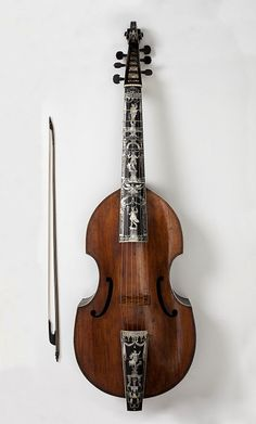 Bass Viol        Place of origin:  Hamburg, Germany,  Date: 1726,   Artist/Maker:        Voigt, Martin,   Materials and Techniques:        Ebony inlaid with mother-of-pearl, ebony ribs with ivory stringing