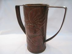 Hammered copper two handled vase made by the Newton classes to a design by John Williams, circa 1895.
