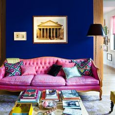 Featuring hot pink roller blinds and collected art in abundance, Annie Schlechter and Russell Maret's Manhattan apartment is a budding collector's dream Living Room Sofa, Home Living Room, Pink Roller Blinds, Roller Shades, Manhattan Apartment, Pink Sofa, L Shaped Sofa, Sofa Styling, Blue Walls
