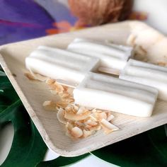 Craving coconut? Try making these homemade coconut popsicles with this easy recipe. Creamy coconut popsicles are a fun healthy homemade dessert option. Snag the recipe and more summer treat ideas at Parties With A Cause. #homemadepopsicle #coconutpopsicle #coconutcream