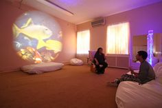 School psychologist Patricia Urgo talks with Andrew Smith-Hinson, 18, in a sensory room at the Felician School for Exceptional Children in Lodi, N.J. The room, which utilizes soft furniture, special lights, optics and other features, is designed to help children with disabilities calm down. (Chris Pedota/The Record/TNS)