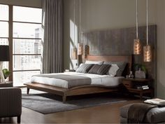 Contemporary master bedroom in warm brown tones with copper  pendant lamps