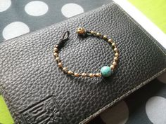 A personal favorite from my Etsy shop https://www.etsy.com/listing/166354516/single-gold-brass-beads-round-turquoise