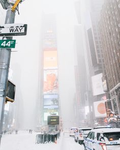 Times Square under the blizzard by Aaron Weiss | via newyorkcityfeelings.com - The Best Photos and Videos of New York City including the Statue of Liberty Brooklyn Bridge Central Park Empire State Building Chrysler Building and other popular New York places and attractions.