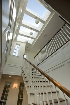 Vincere Interiors brings the outside in with large skylights and windows. Sorenson Pendants fit perfectly above the traverse staircase. Skylight Design, Roof Skylight, Window Design, Interior Design Portfolios, Interior Design Images, Stair Well, Roof Lantern, Bungalow House Design, Transitional House