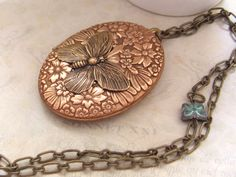 Butterfly In Motion, 70s vintage copper and brass locket necklace with glass butterfly beads. $43.50, via Etsy.