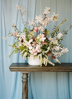 Magnolia branches in an arrangement by McKenzie Powell