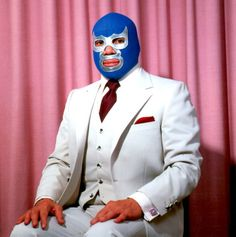 Lourdes Grobet. Love the book: Lucha Libre, the family portraits. The Family Portraits, Grobet shows the wrestlers with their mothers, wives and girlfriends, sitting for what would almost be a generic family portrait, but for the fantastic costumes of the luchadores themselves.