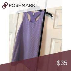 Women's Under Armour Tank Women's Under Armour athletic tank! Perfect condition. Size small. Nylon material. Lavender color with stripes Under Armour Tops Tank Tops
