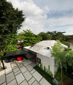 Polished, bush-hammered and board-marked concrete all feature at this Singapore house