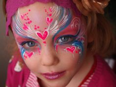Such an amazing face painting design. I could never duplicate it but I could try my hand at something similar.