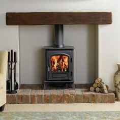 Wood burner with wooden mantle and brick base. , Wood burner with wooden mantle and brick base. Small Wood Burning Stove, Small Stove, Small Log Burner, Gas Log Burner, Log Burner Living Room, My Living Room, Small Living, Wood Burner Fireplace, Brick Fireplaces