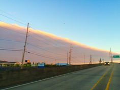 Cloud front in the sky by Melanie Starr