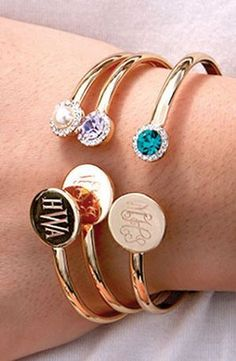 Our gold tone cuff bracelet features your engraved monogram and a simulated birthstone.