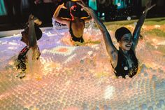Pool Party Guests Swim With 65,000 Interactive Ping Pong Balls [Video]