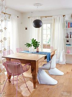 Formerly a florist shop's workstation, the patina-rich furniture piece became the breakfast table after Jen cut nearly a foot off the legs. Pink spray paint gives vintage Russell Woodard metal chairs a sassy new look that pairs well with the door beads and vases./