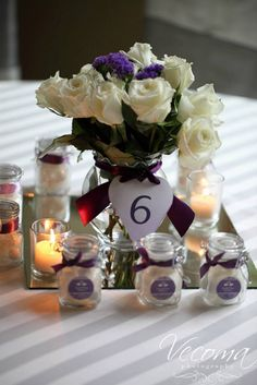 Cute centerpiece numbers with creative candy jar favors! #weddingfavors  #centerpieces  @Vecoma at the Yellow River