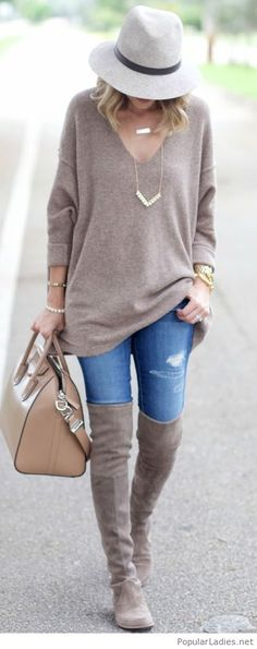 Blue jeansm grey boots and sweater