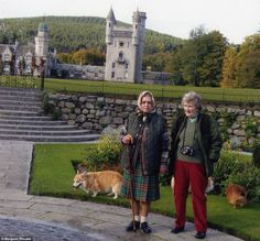 Enjoying the garden:  the Queen, resplendent in her kilt, pausing for a snap during a quiet stroll around Balmoral with cousin Margaret Rhodes.