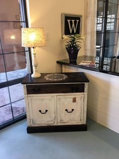 white chalk painted and distressed cabinet with lined shelves and drawer....too cute