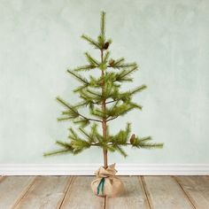 "Enjoy a beautiful holiday accent year after year with this faux pine tree wrapped in burlap.- Plastic, glue, wire, burlap- Indoor use only- Imported48""H, 32"" diameter"