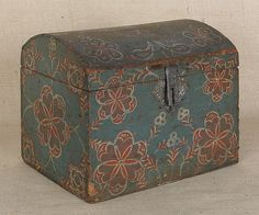 "Pennsylvania Compass Artist painted dome lid box, ca. 1800-1840, decorated with typical red and white geometric stylized flowers on a blue background, 10 1/4"" h., 11 3/4"" w., 9 1/2"" d. Similar examples were sold at the Pook & Pook, Inc., Shelley sale in 2007, the Machmer sale in 2008, and the Smith sale in 2010. Other examples are included in Wendy Cooper and Lisa Minardi, Paint, Pattern and People."