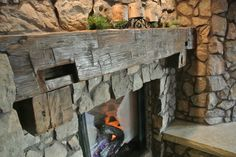 stone fireplace with reclaimed wood mantel