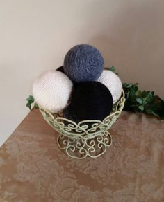 Check out this item in my Etsy shop https://www.etsy.com/listing/502634332/decorative-yarn-balls-black-gray-cream