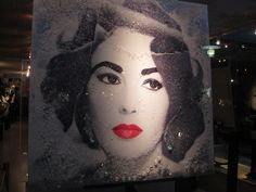 Awesome mixed media of Liz hanging in South Beach