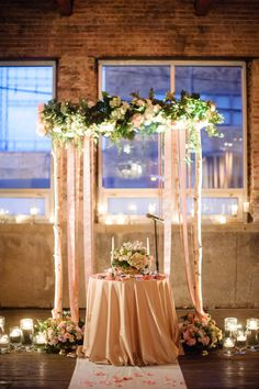 Glam ceremony decor in an industrial-style loft | Photography: Averyhouse - averyhouse.net Read More: http://www.stylemepretty.com/2014/08/07/industrial-chic-chicago-wedding/