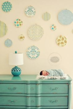@Sarah Whitesides.  @Jessie Staab.  so, paper your walls with a solid neutral, and use scrapbook paper for your circles!
