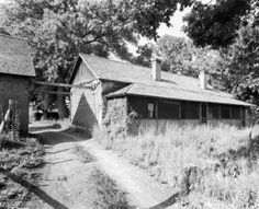 ... Plaza (later the Francisco Fort Museum), formerly a fort; shows two adobe brick buildings with gabled roofs in La Veta (Huerfano County), Colorado.